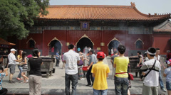 Buddhists pray inside the Yonghe Temple Temple, Beijing, china. Stock Footage