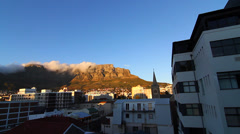 Pan view of the famous table mountain with sun Stock Footage