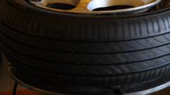 Mechanic removes car tire closeup. Stock Footage
