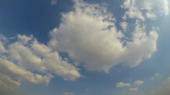 White clouds running over blue sky. - stock footage
