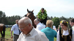 Man rider winner on horse get awards oak garland and cup Stock Footage