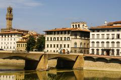 Houses, arno river and ponte vecchio bridge of florence, tuscany, italy Stock Photos