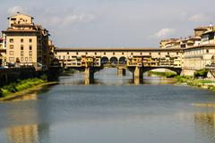 houses, arno river and ponte vecchio bridge of florence, tuscany, italy - stock photo