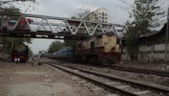 TRAIN LOCOMOTIVE: Yellow train passes one way, blue train passes the other Stock Footage