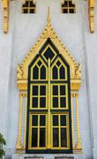Thai style golden window of temple Stock Photos