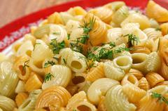 colorful italian conchiglie  pasta - stock photo