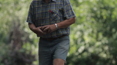 Elderly people enjoying to play boules in a park, ball shooting Stock Footage