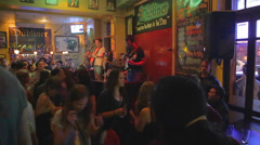 A live band and a dancing crowd at a popular bar on long street Stock Footage