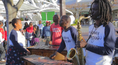 A local capetown band at the Capetown waterfront plays a song for the public Stock Footage