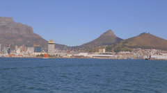 A pan of table mountain as seen from a boat heading to Robben island Stock Footage