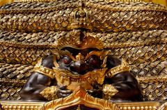Image of rahu statue at the temple in thailand Stock Photos