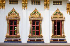 golden windows of temple in bangkok thailand. - stock photo