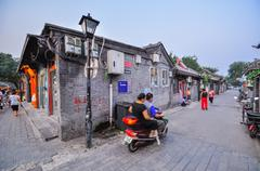 a hutong behind all the bars in houhai area, beijing - stock photo