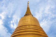 Chedi gold in temple bangkok thailand Stock Photos