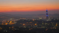 Golden sunset aerial pan of downtown pretoria and Telekom tower Stock Footage