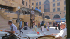 People taking pictures of the statue at Mandela square Stock Footage