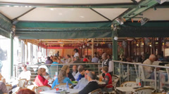 People enjoying patio lunch dining at Nelson Mandela square Stock Footage