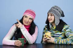 Two women point and looking up Stock Photos
