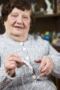 Grandma knitting - stock photo
