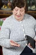 Pensioner counts her last money Stock Photos