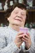Older woman with candle light - stock photo