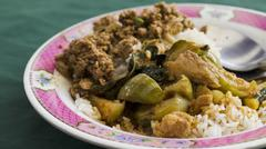 Thai food menu rice with chickencurry and minced pork Stock Photos