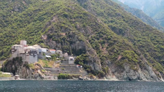 Ship sails along peninsula of Athos, autonomous monastic state in Greece Stock Footage
