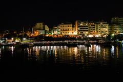 piraeus marina port in the night - stock photo