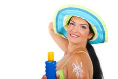 Beautiful woman with sun protection lotion - stock photo
