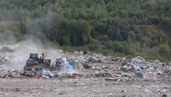 Bulldozer on the city dump Stock Footage