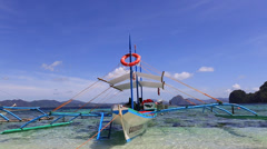 Tourist boats on the beach in El Nido, Philippines Stock Footage