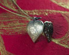 close up of Pendant vintage heart shape necklace - stock photo