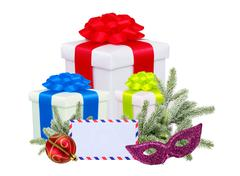 christmas gifts with post card and branch firtree isolated on white backgroun - stock photo