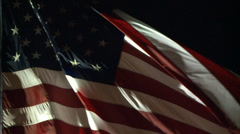 AMERICAN FLAG USA WAVING LITE AT NIGHT IN WIND LONG SLOW MOTION HD - stock footage