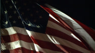 Stock Video Footage of AMERICAN FLAG USA WAVING LITE AT NIGHT IN WIND LONG SLOW MOTION HD