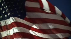 AMERICAN FLAG USA DRAMATIC WAVING NIGHT IN WIND LONG CLIP HD - stock footage