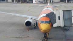 Checking engine, Nok Air plane at Don Muang Airport, Bangkok Stock Footage