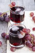 Chilled red grape juice Stock Photos