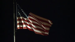 AMERICAN FLAG USA DRAMATIC REAL TIME AT NIGHT MEDIUM SHOT HD HIGH DEF - stock footage