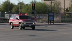 Stock Video Footage of Fire Department Vehicle Races Through Intersection