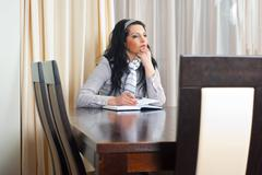 Thinking woman planning the meeting - stock photo
