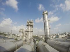 refinery tower in wide lens - stock photo