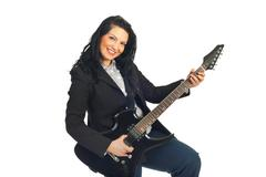 Cheerful guitarist woman in formal wear - stock photo
