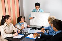 Presentation on board at business meeting - stock photo