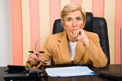 Serious senior business woman - stock photo