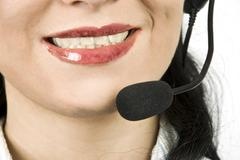 Close up helpdesk agent with headset - stock photo