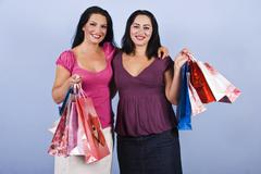 Beautiful women at shopping with bags - stock photo