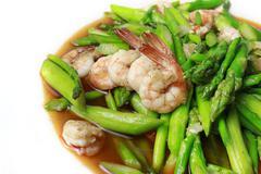 Stock Photo of stir fried prawns with asparagus