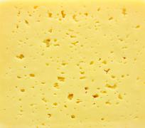 Background of fresh yellow swiss cheese with holes Stock Photos