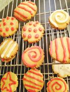 Decorated cookies on cooling rack - stock photo